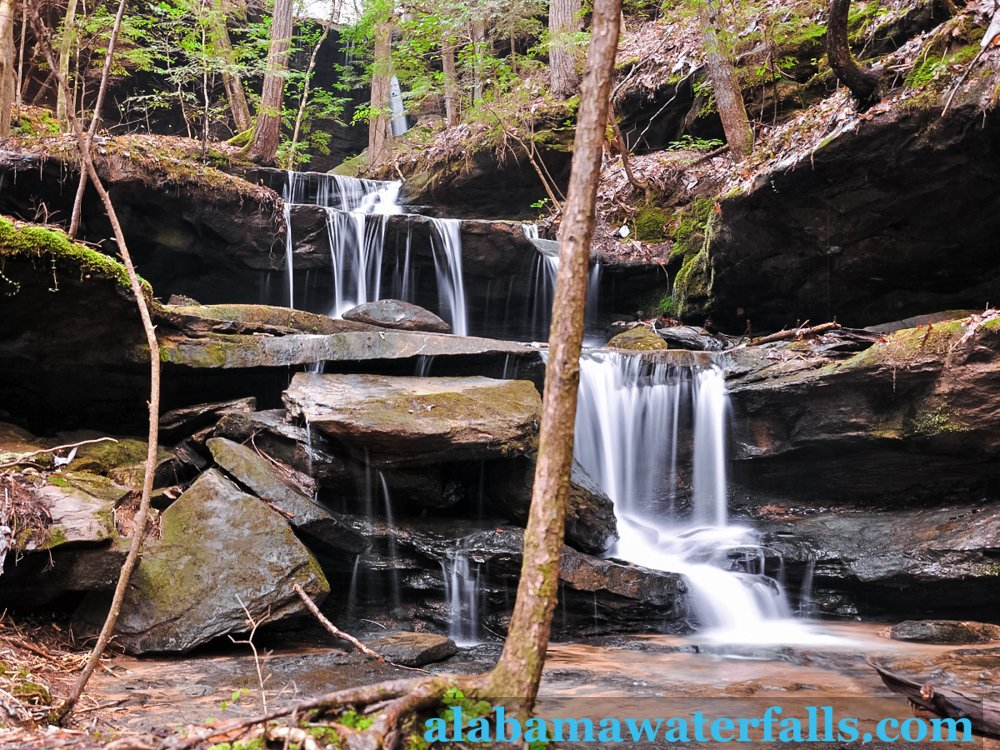 This cascading waterfalls is surrounded by  moss and rock walls of the canyon adding beauty to it.